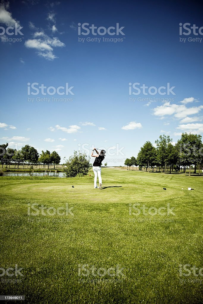 young woman playing golf, sport stock photo