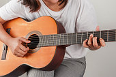 istock Young woman playing guitar classic of relaxation music 1152433986