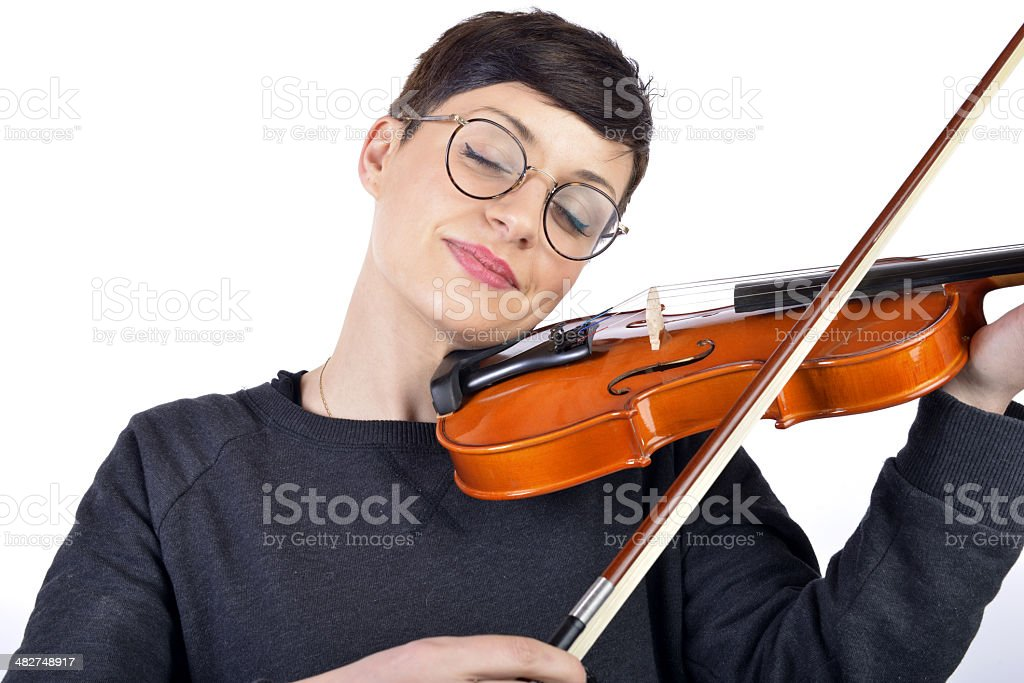 young woman playing her violin royalty-free stock photo