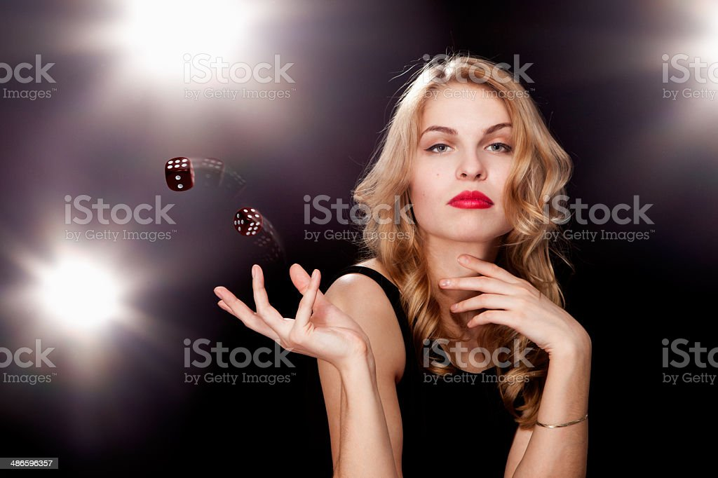 Young woman playing in the gambling stock photo