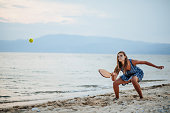 istock Young woman playing paddle ball at the beach 1266078464