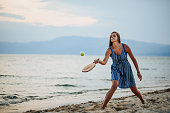 istock Young woman playing paddle ball at the beach 1266078474