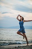 istock Young woman playing paddle ball at the beach 1266078538