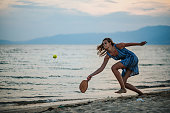 istock Young woman playing paddle ball at the beach 1266078551