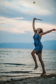 istock Young woman playing paddle ball at the beach 1266078602