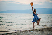 istock Young woman playing paddle ball at the beach 1266078720