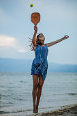 istock Young woman playing paddle ball at the beach 1266078774