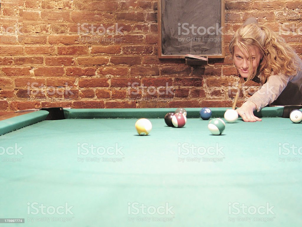 Young woman playing pool royalty-free stock photo