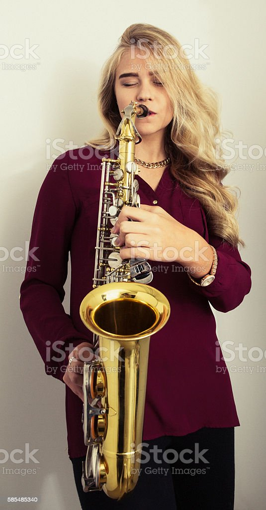 Young woman playing saxophone stock photo
