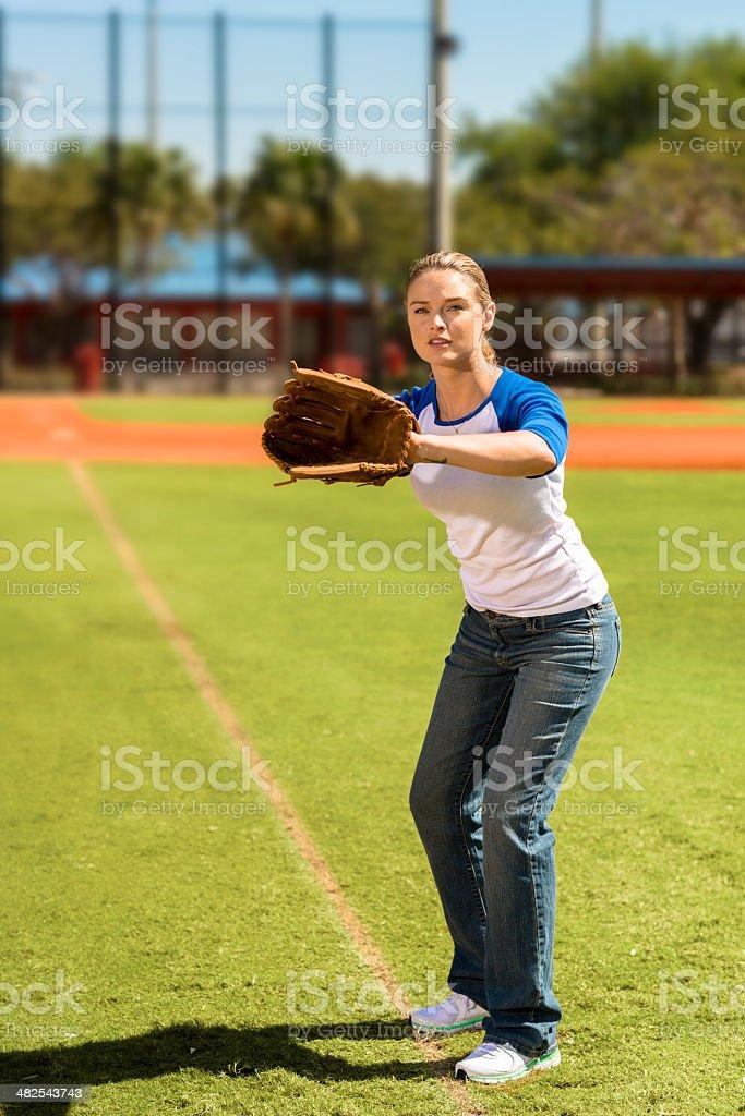 Young Woman Playing Softball stock photo