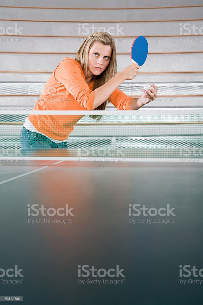 A young woman playing table tennis royalty-free 스톡 사진