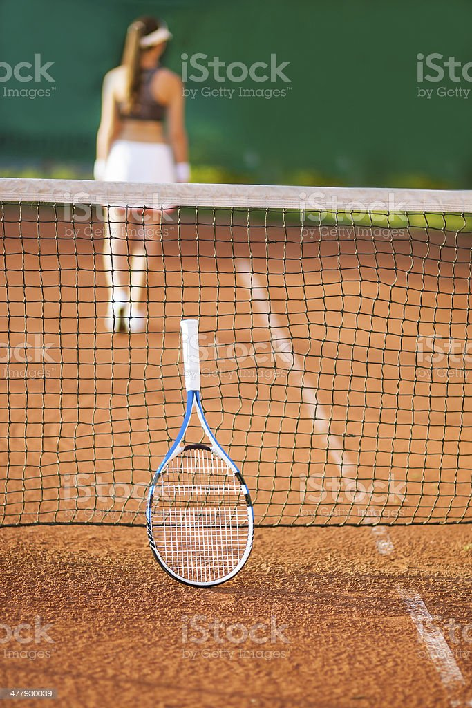 young woman playing tennis on court royalty-free stock photo