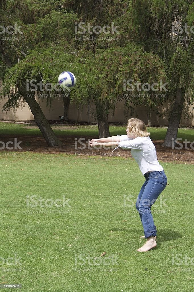 Young Woman Playing Volleyball in the Park royalty-free stock photo