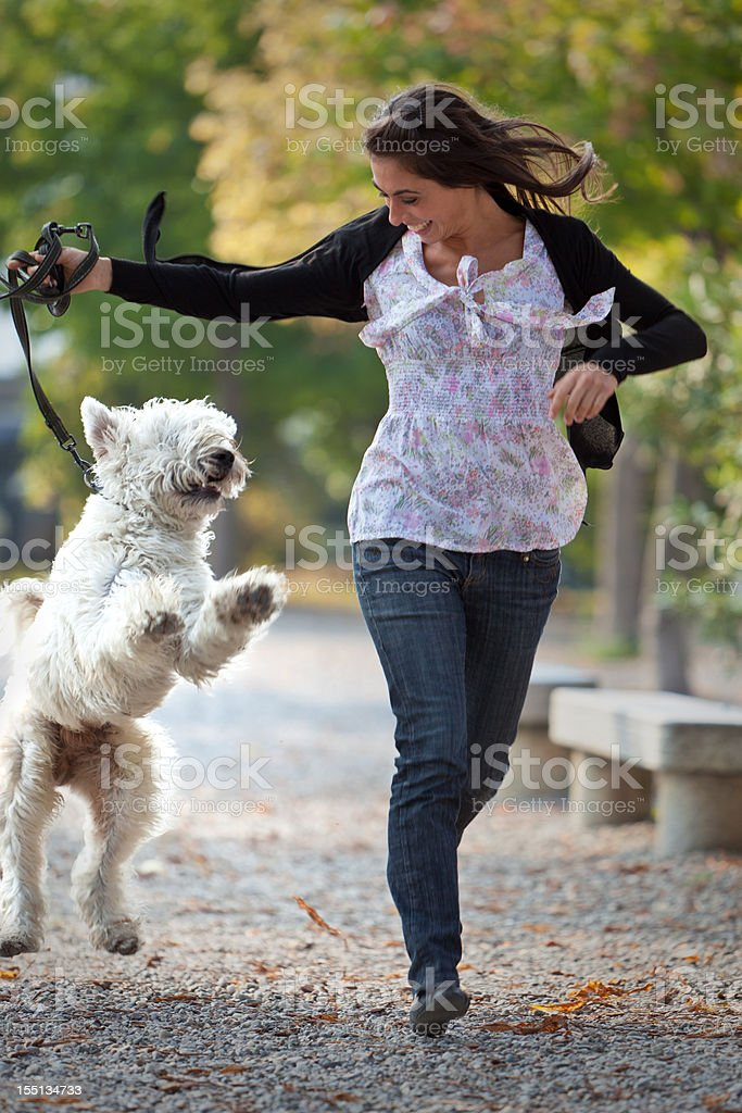 Young woman playing with her dog royalty-free stock photo