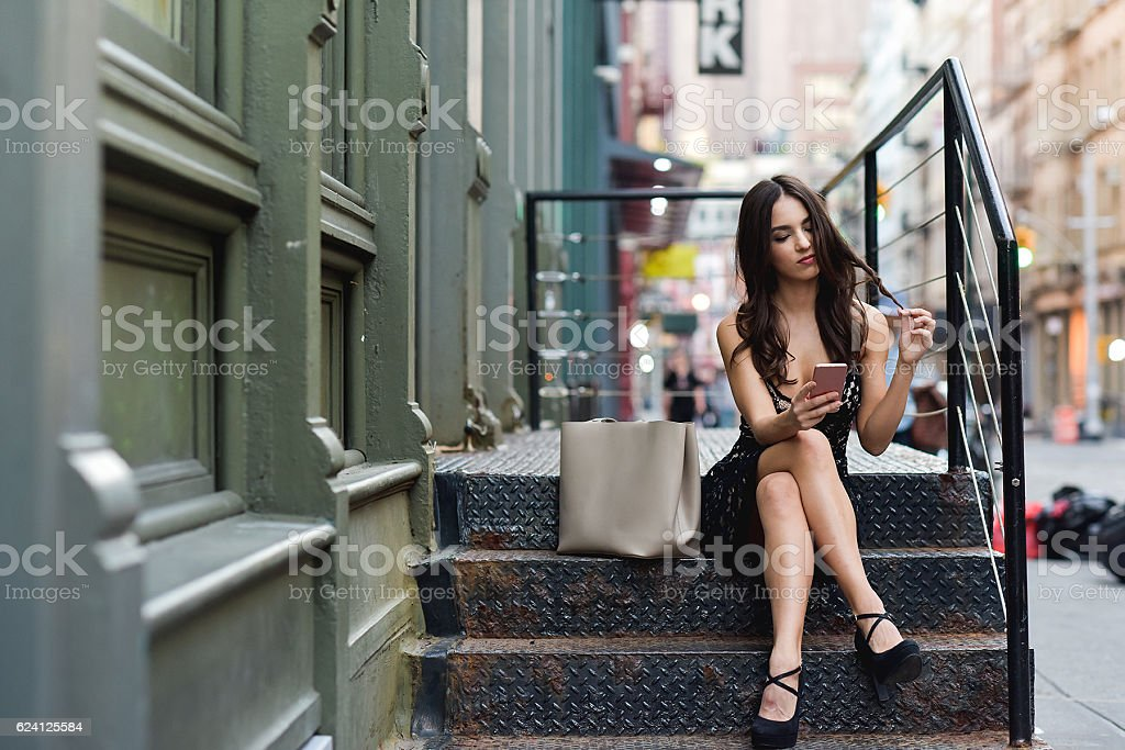 Young Woman Playing with her Phone stock photo