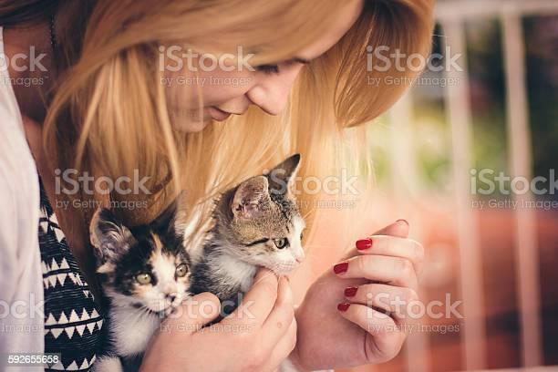 Young woman playing with two kittens outside picture id592655658?b=1&k=6&m=592655658&s=612x612&h=m5d94xmqlhwgkabvjl44wpknqbaghygr5mbk8d7npie=
