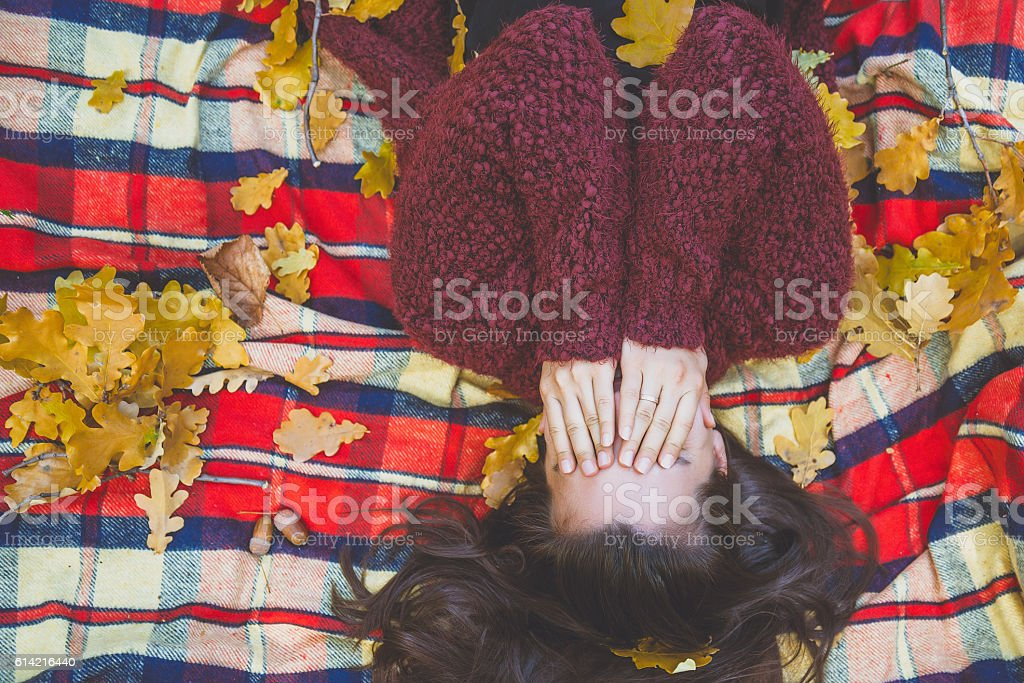 Young woman plays with leave stock photo