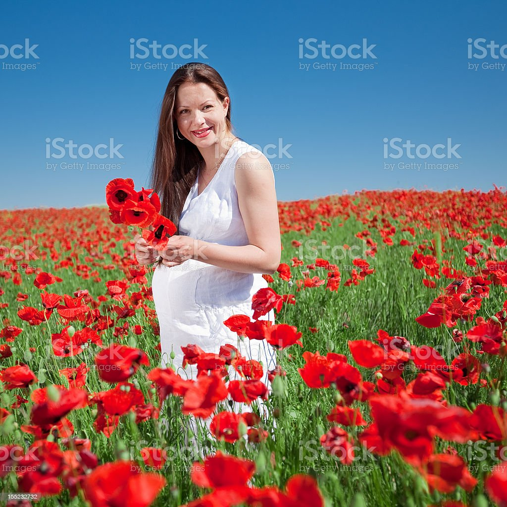 Young woman plucks flowers royalty-free stock photo