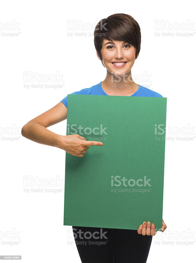 Young woman pointing at a green sign royalty-free stock photo
