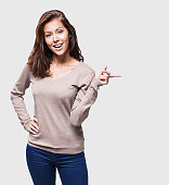 istock Young woman pointing at copy space 625750608