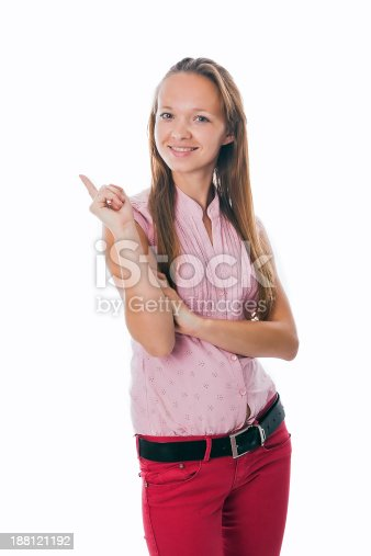 1045527172 istock photo Young woman pointing at white background 188121192
