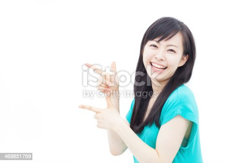 istock young woman pointing copy space 469851759