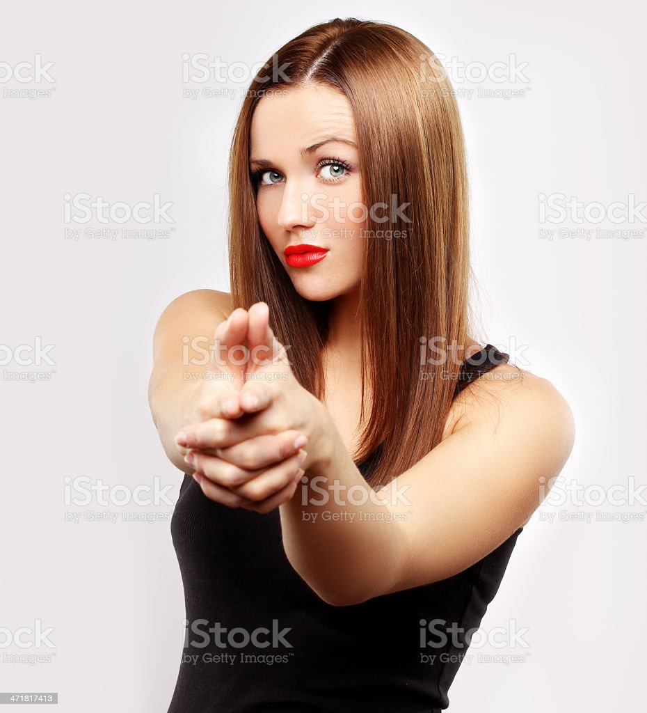 Young woman pointing finger at the camera. royalty-free stock photo