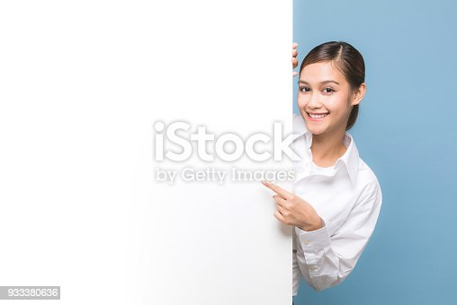 933380808 istock photo Young woman pointing message board. 933380636