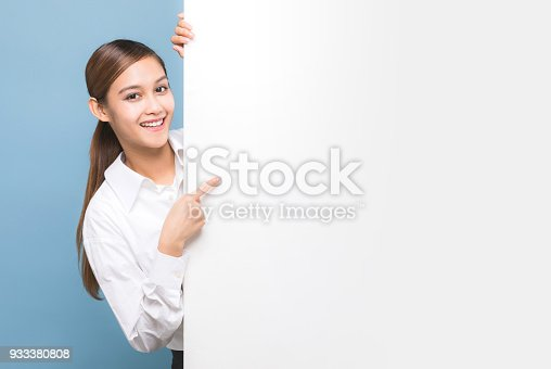 933380808 istock photo Young woman pointing message board. 933380808