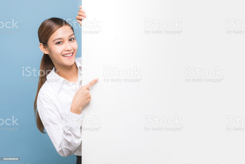 Young woman pointing message board. stock photo