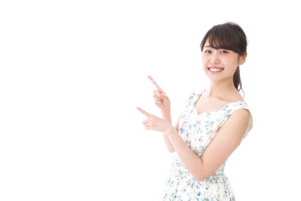 若い女性の指を指す - 指差す ストックフォトと画像