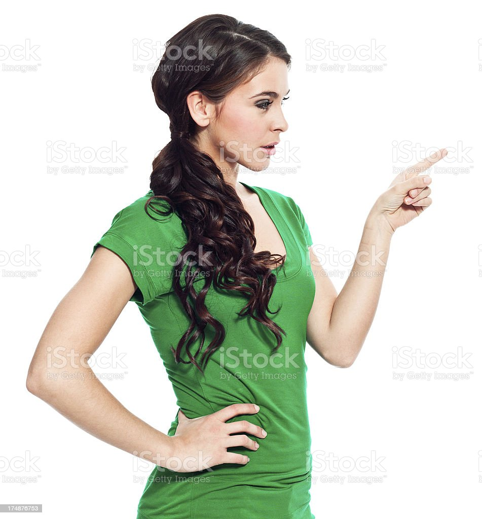 Young woman pointing Portrait of beautiful young woman pointing at the copy space. Studio shot, isolated on white. 20-24 Years Stock Photo