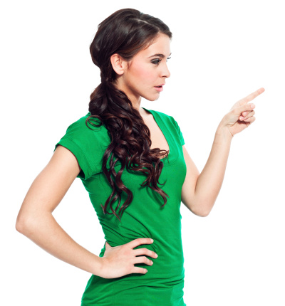 Young Woman Pointing Stock Photo - Download Image Now