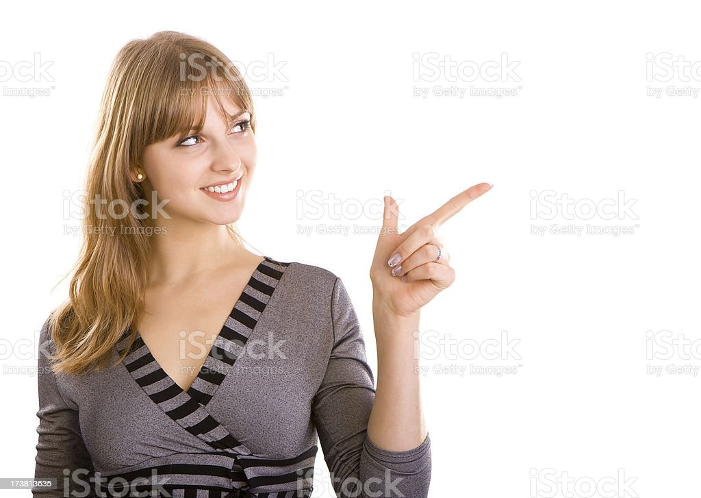 Young woman pointing something on her left-upwards royalty-free stock photo