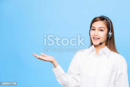933380808istockphoto Young woman pointing something. 933347746