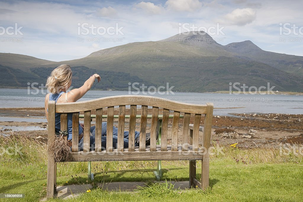 Young Woman Pointing to Mountain royalty-free stock photo