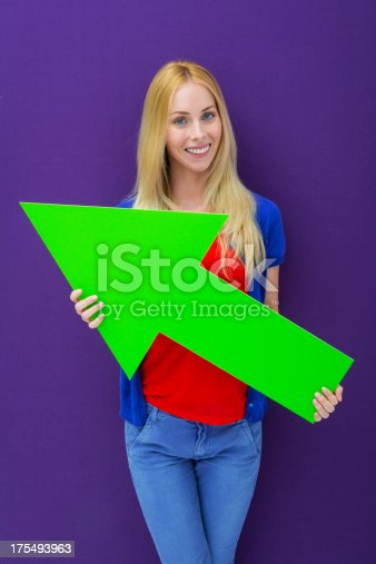 168589045istockphoto Young woman pointing with a green arrow 175493963