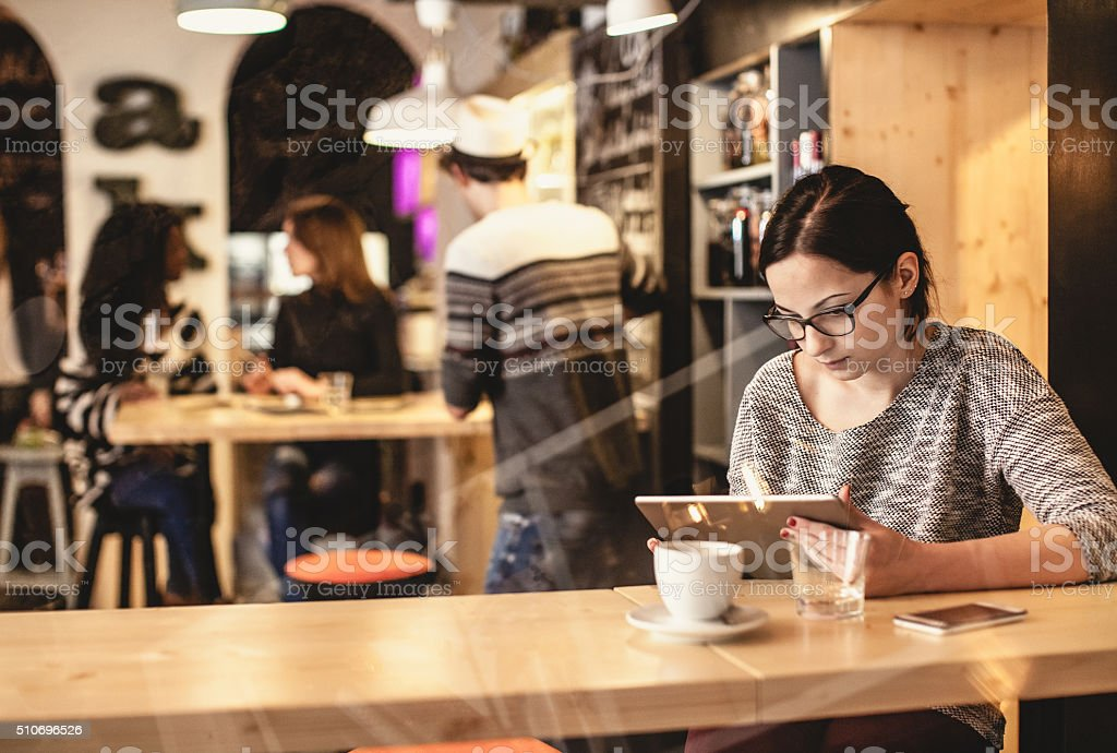 Young woman portrait at the restaurant stock photo