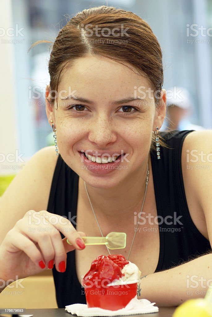 Young woman portrait eating ice-cream royalty-free stock photo
