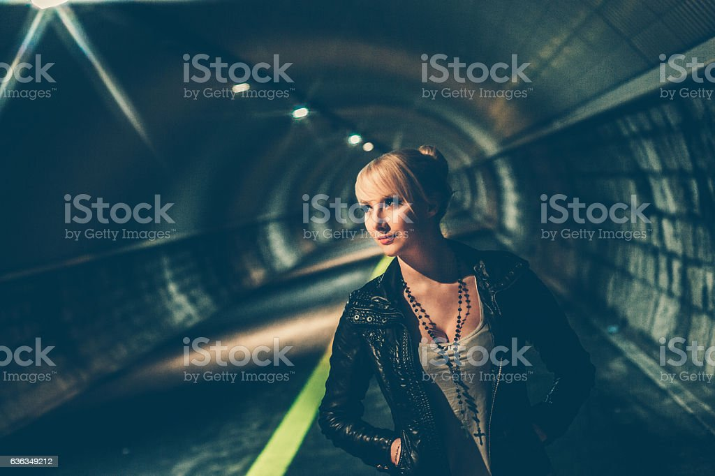Young Woman Portrait in the Pedestrian Underground Tunnel stock photo