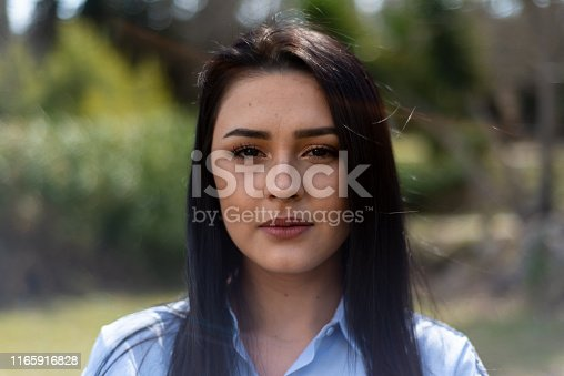 Young Woman Portrait in the Public Park