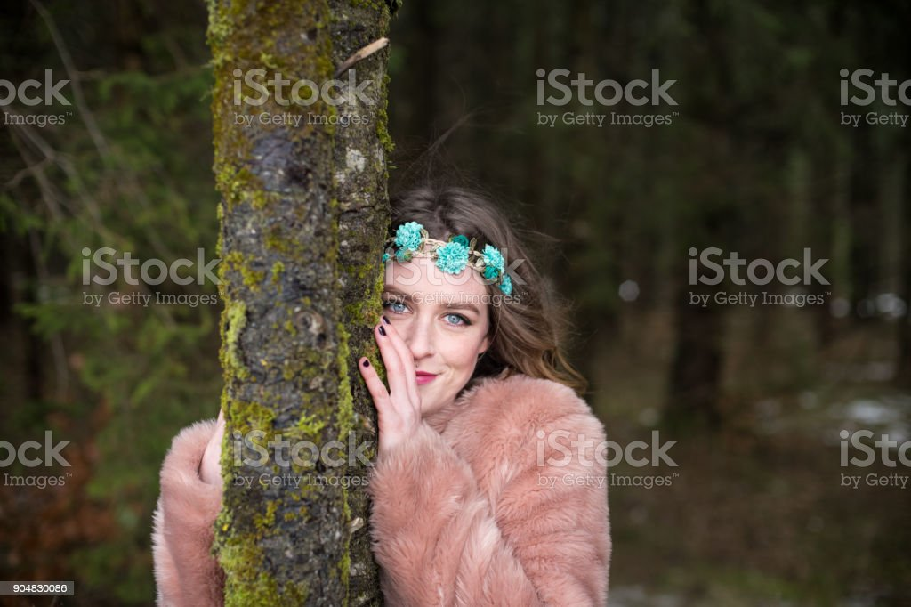 Young woman portrait outdoors in the forest stock photo