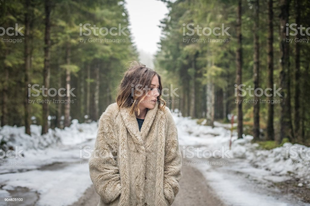 Young woman portrait outdoors in the woods stock photo
