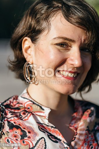 istock Young woman portrait outdoors 1144198605