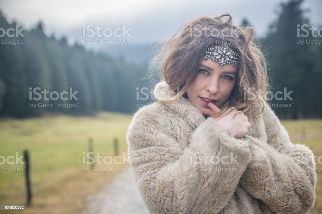 Young woman portrait outdoors stock photo