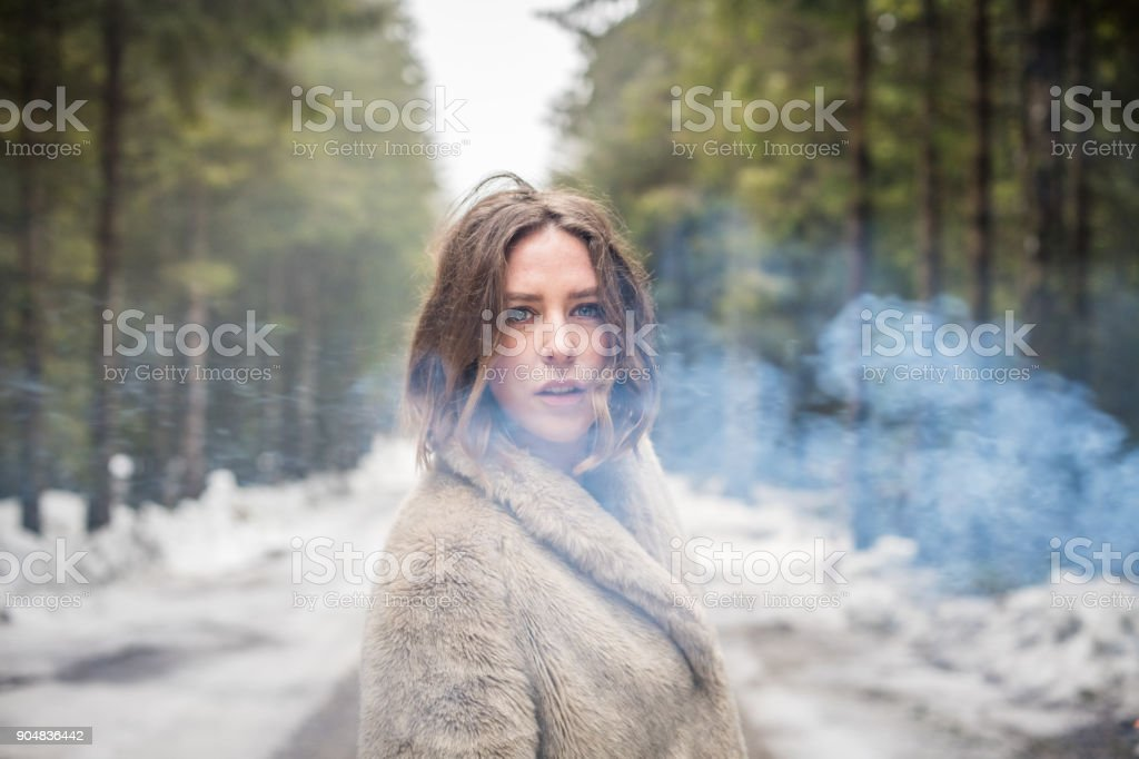 Young woman portrait outdoors with pink smoke bomb stock photo