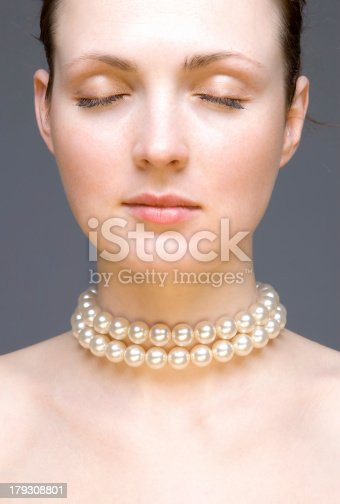Young woman portrait - studio shot isolated on the grayCheck also: