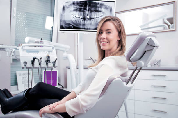 Young woman portrait visiting the dentist and smiling stock photo