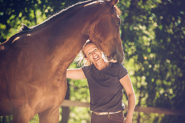 young woman portrait with her horse - pferdepflege stock-fotos und bilder
