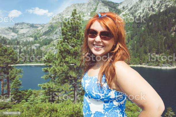 Young woman poses at beautiful Fannettte Island in Lake Tahoe California.